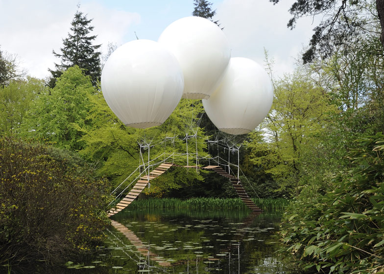 French artist Olivier Grossetête used three enormous helium balloons to float a rope bridge over a lake in Tatton Park, England