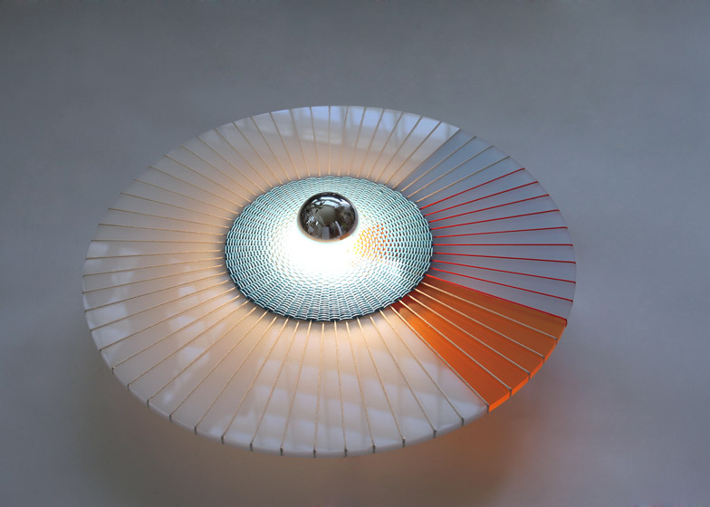 Marta Bakowski uses thread to create patterns across Rays lamps
