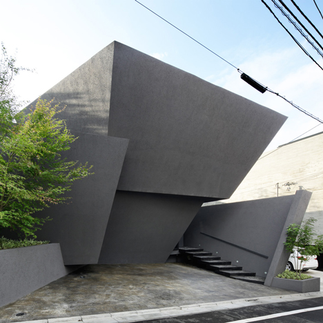 Angular black walls fold around SRK home in Tokyo by ARTechnic Architects