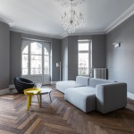 YCL adds colourful furniture accents to monochrome Strasbourg apartment
