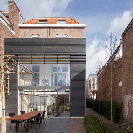Reset Architecture adds modern wood and glass extension to a traditional brick townhouse