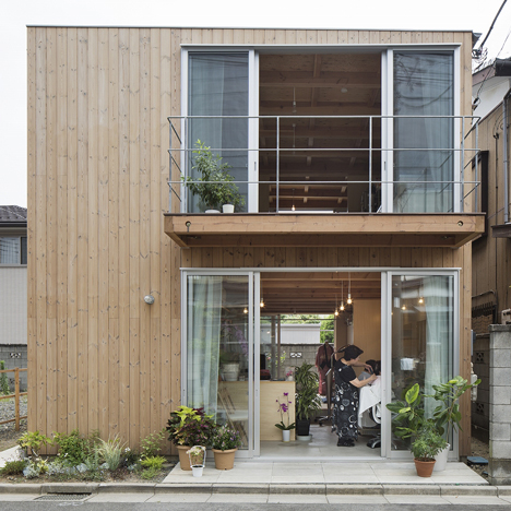 Wooden house by Suzuki Architects also contains a hair salon and a writing studio