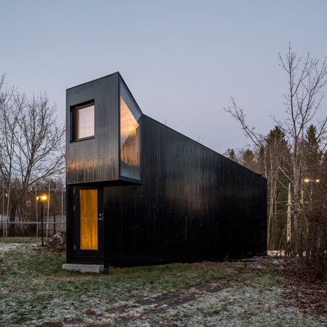 Tiny timber cabin by Jarmund/Vigsnæs has windows incorporated in its angled facades