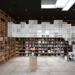 Box-like shelving covers walls in SoNo Arhitekti's Book Centre Trieste shop