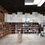 Box-like shelving covers walls in SoNo Arhitekti's Book Centre Trieste shop