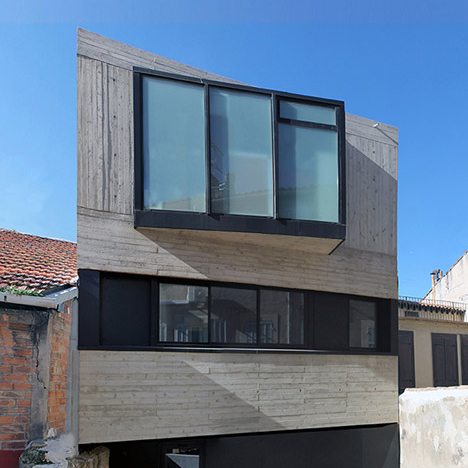 Marseille house by ACAU Architects features board-marked concrete and an angular window