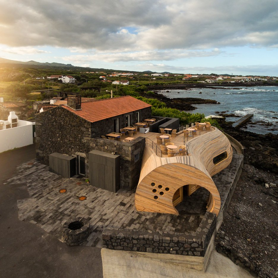 Cella Bar by FCC Arquitectura features a volcanic stone barn and a whale-inspired extension