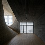 Archi-Union Architects completes Shanghai arts space with sweeping concrete walls