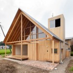 Family house in Japan designed by Tailored Design Lab to embrace its farmland setting