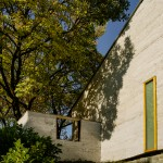 Hemp-based render gives striated skin to renovated house by Martens Van Caimere