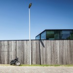 Govaert & Vanhoutte's House Graafjansdijk features fence-like walls and glazed living spaces
