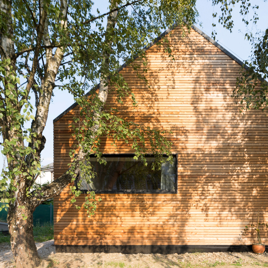 Martin Boles creates barn-inspired house with an extra floor slotted beneath its pitched roof