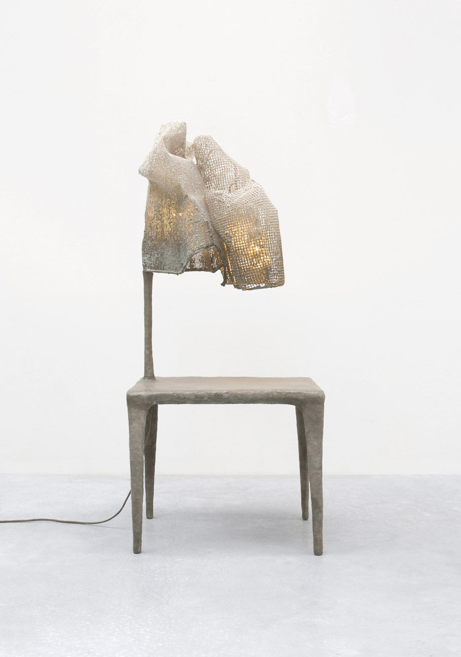 Nacho Carbonell wraps lamps in mesh cocoons for Carpenters Workshop exhibition