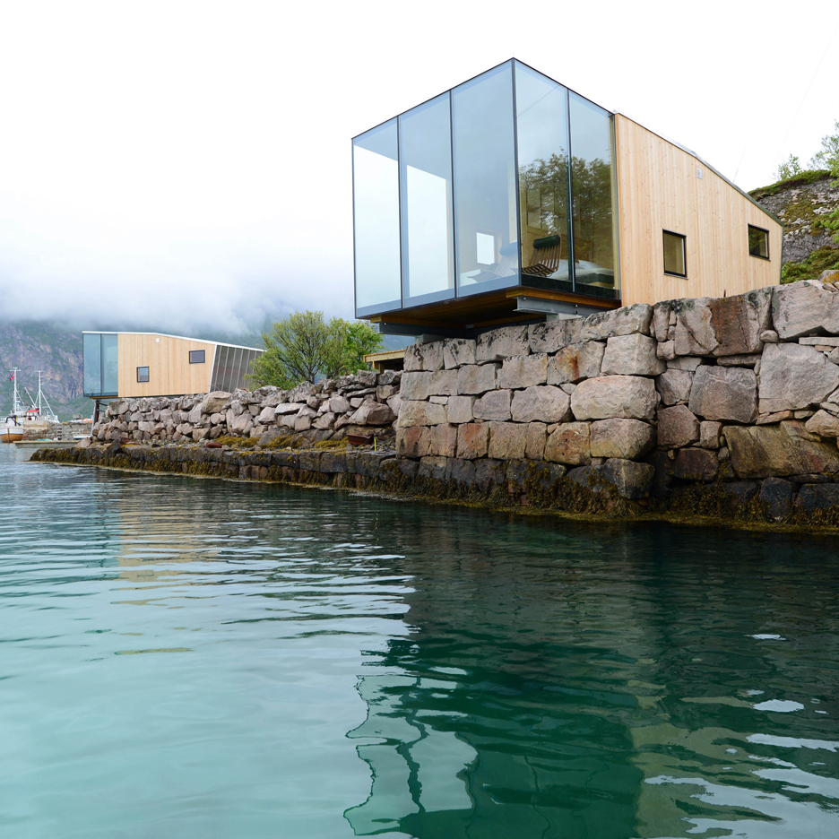Arctic exploration cabins by Snorre Stinessen cantilever over the Norwegian shoreline