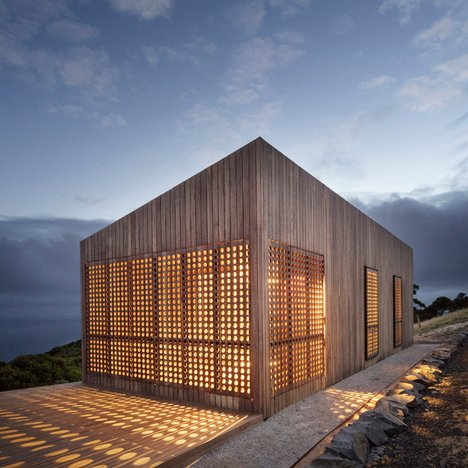 Perforated shutters provide light and ventilation for Moonlight Cabin by Jackson Clements Burrows