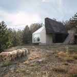Serbian mountain home by EXE Studio clad in both white ceramic tiles and dark wooden shingles