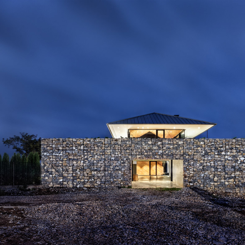 Observation House by I/O Architects features gabion walls and a grassy viewing deck