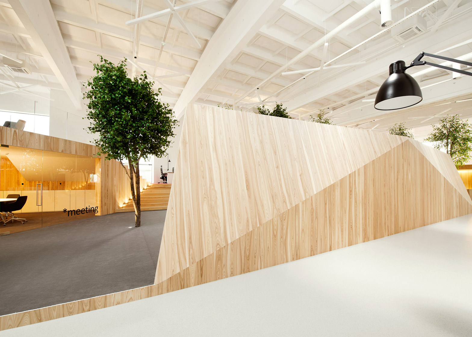 Kamp arhitektid creates tree filled office within former factory