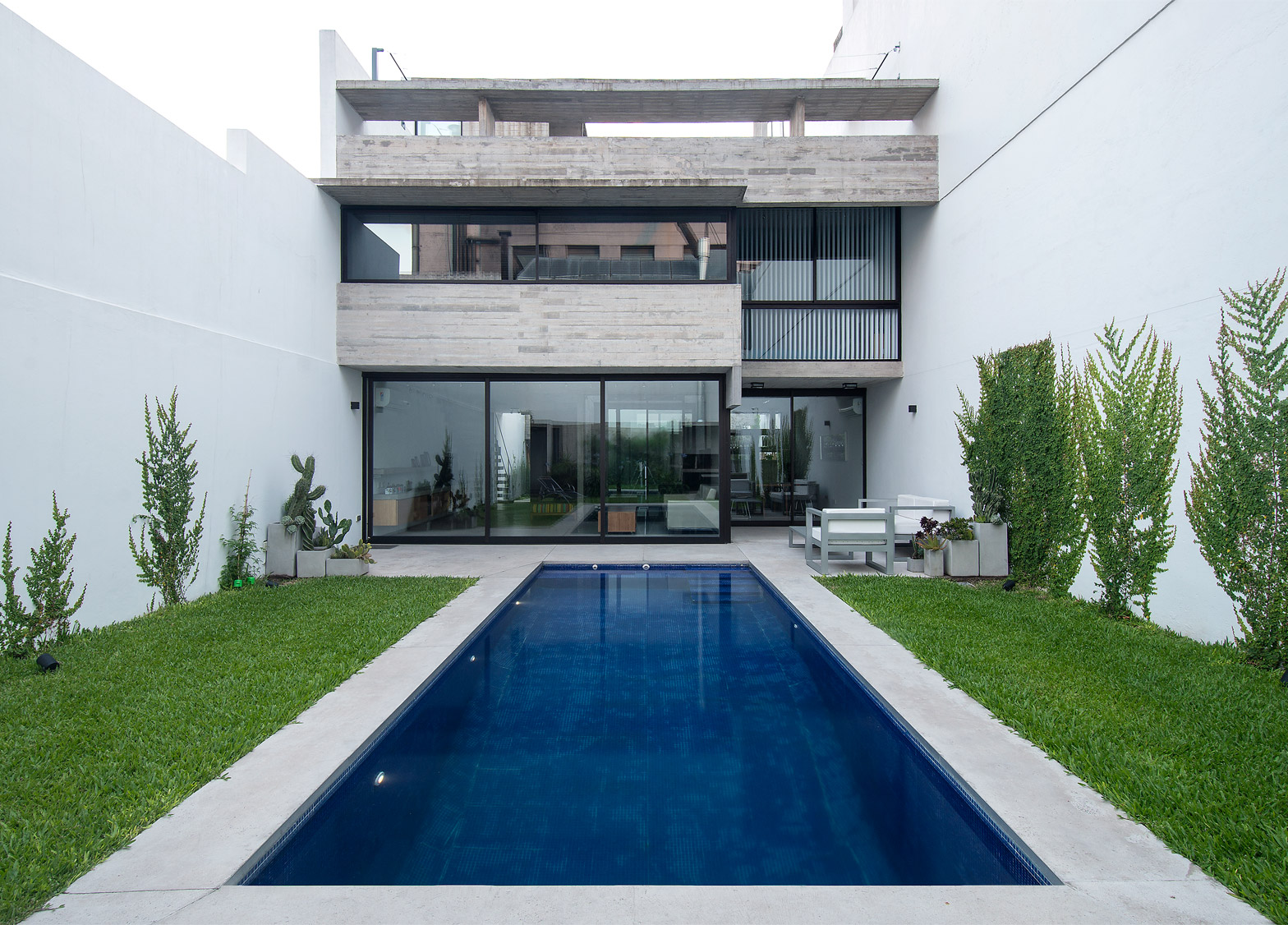 Two Houses Conesa by Luciano Kruk