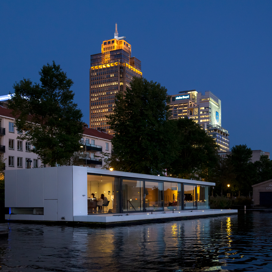 Floating home by +31 Architects is moored on an Amsterdam river