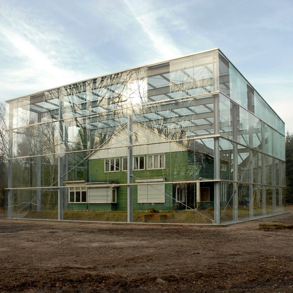 Oving Architecten shrouds concentration camp house in glass as a memorial to the holocaust