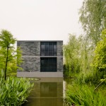 "David Chipperfield creates ""village"" of stone dwellings in Hangzhou marshland"