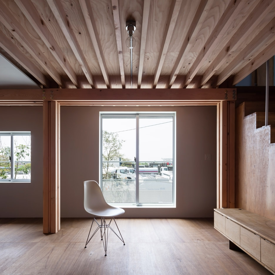 FT Architects' 4 Columns house features a traditional timber frame and minimal interior
