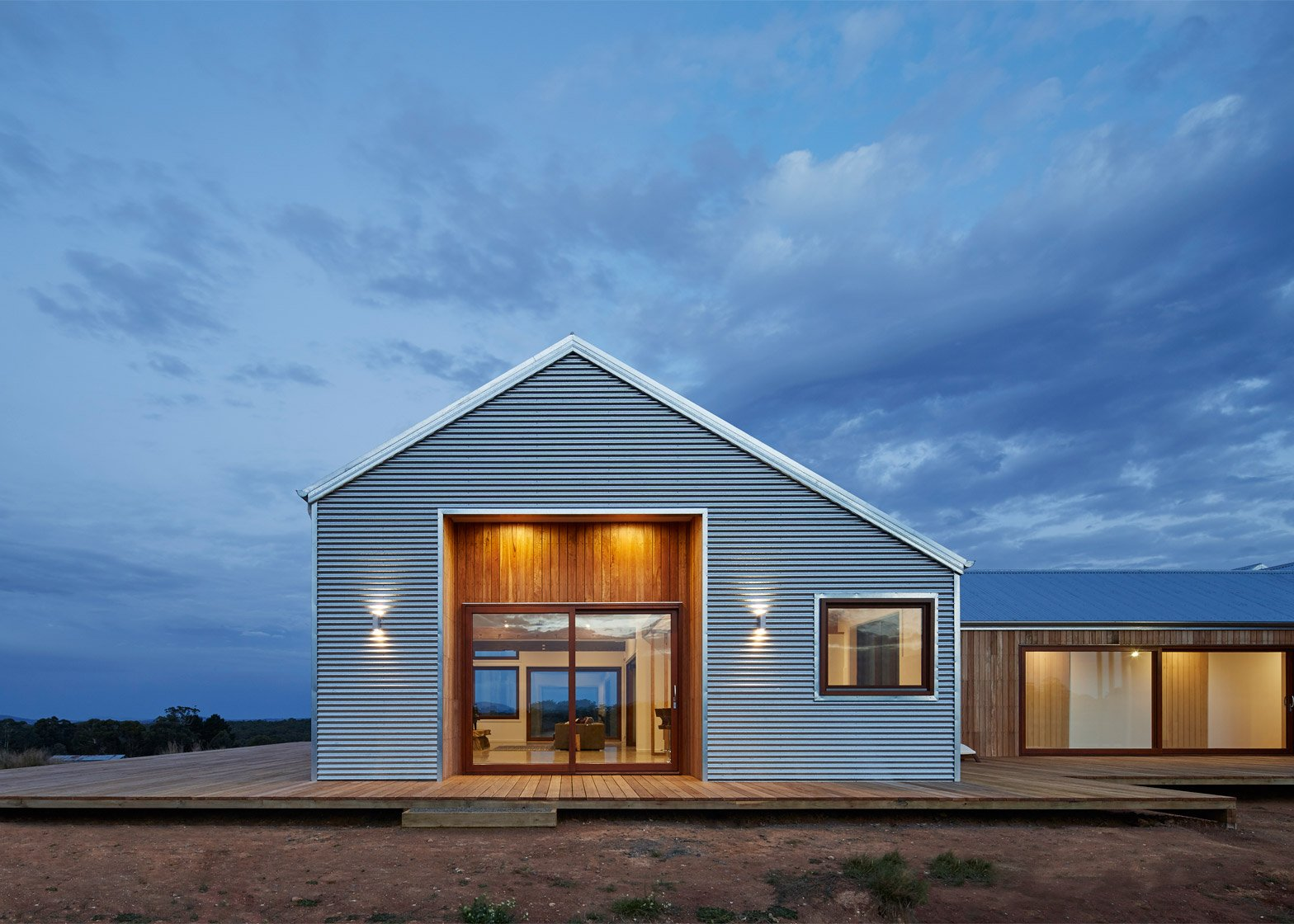 Corrugated steel provides durable facade for house by Glow Design Group