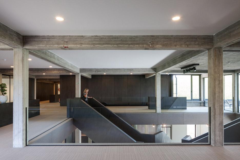 Steven vandenborre adds cross shaped staircase to an for Office design dezeen