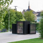 Atelier Kastelic Buffey creates miniature book exchange that folds up into a glowing black box
