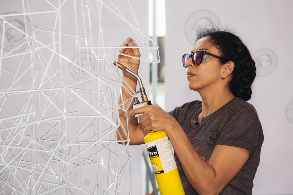 Anjali Srinivasan builds her Archway installation of glass rods at Dubai Design District