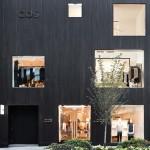 Blackened cedar planks cover the facade of COS Toronto store