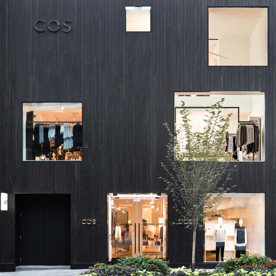 Blackened cedar planks cover the facade of COS Toronto store