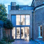 London house extension by Alexander Martin features a double-height window wall