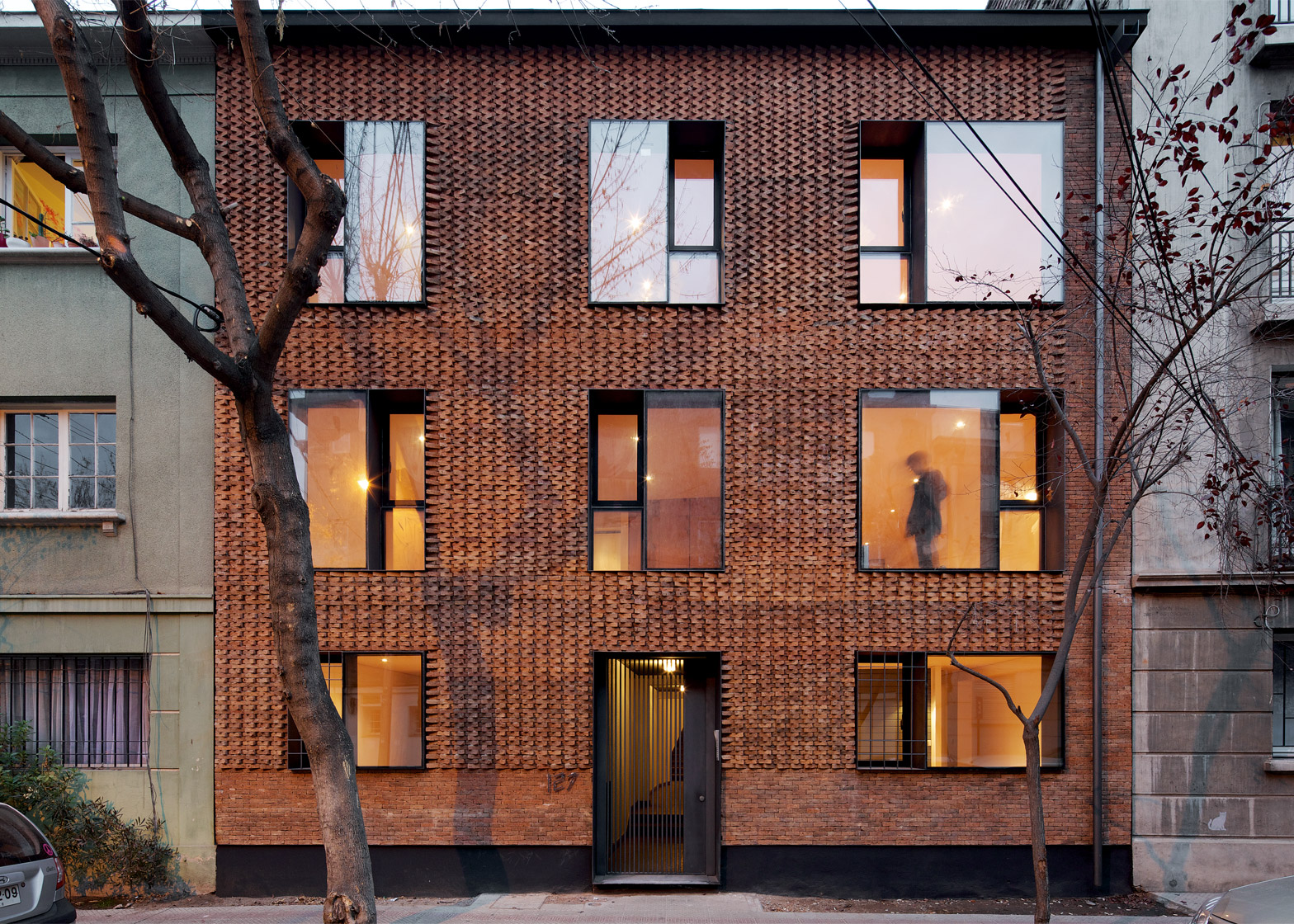 brick apartment building. 1 of 9  Project E RC by MAPA in Santiago Chile updates Chilean housing block with textured brick facade