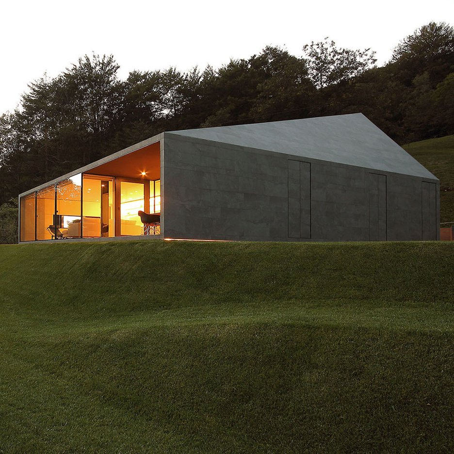 Faceted-home-in-the-Swiss-Alps-by-JM-Architecture-is-covered-in-dark-grey-tiles