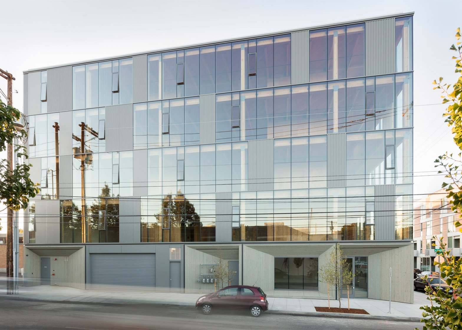 Glass facade architecture  Glass facade reveals timber structure of Portland office building