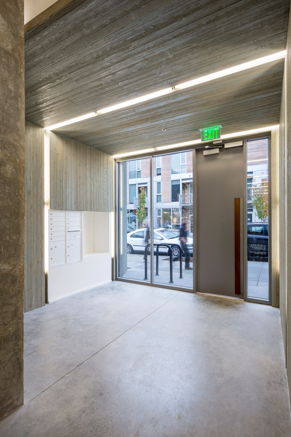 Glass facade reveals timber structure of Frame Work building in