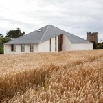 House in Wexford by GKMP Architects features a pyramid-shaped roof