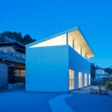 SYAP's House in Yokkaichi has a roof angled upwards like the lid of an open box