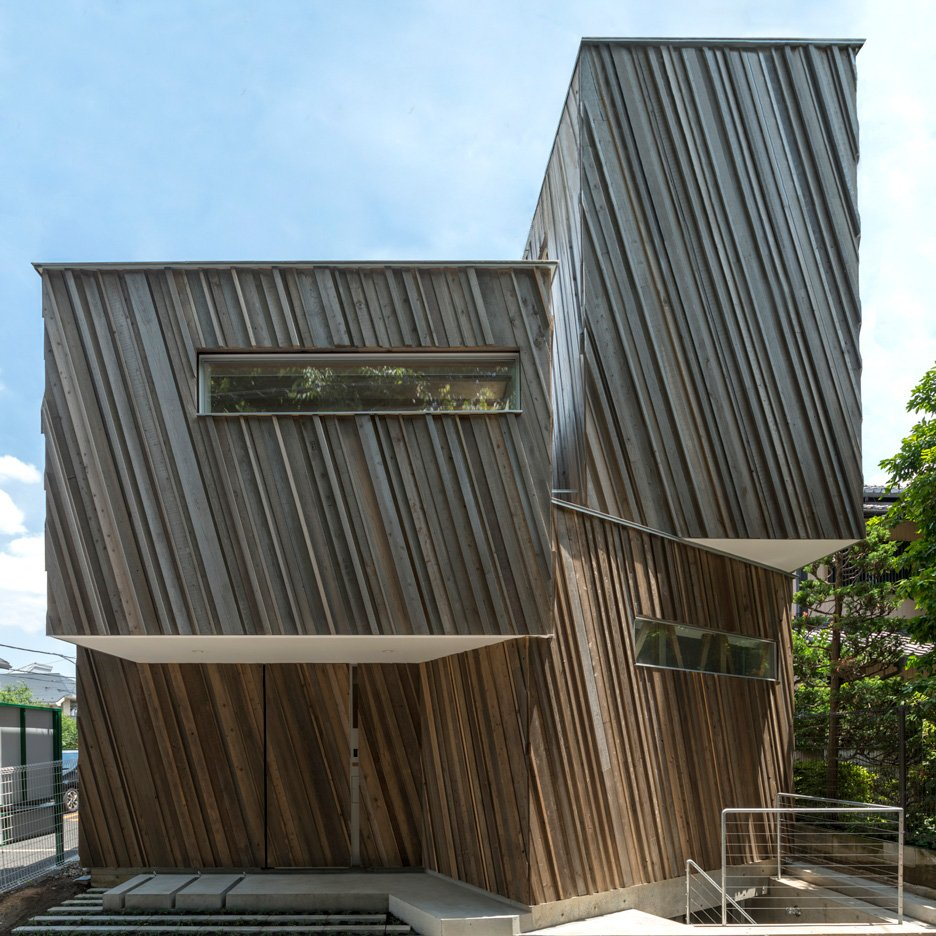 Kyodo House features a sculptural wood facade and an indoor swing
