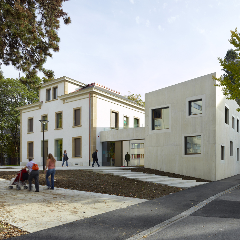 Raw concrete contrasts with 19th-century details at Le Gazouillis kindergarten