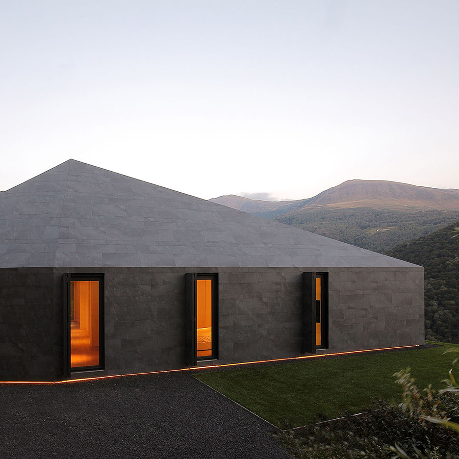 Faceted home in the Swiss Alps by JM Architecture is covered in dark grey tiles