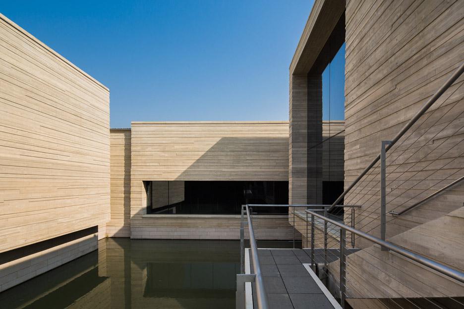 architect news — mu xin art museumoli architecture sits over a