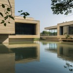 Mu Xin Art Museum by OLI Architecture sits over a lake in eastern China