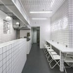 Orang+Utan vegetarian cafe features stark white tiling and neon signage