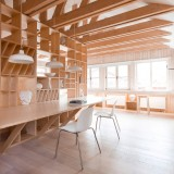 Plywood artist's studio by Ruetemple combines areas for storage, seating and sleeping