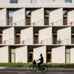 3XN completes Copenhagen hospital building featuring slanted stone walls