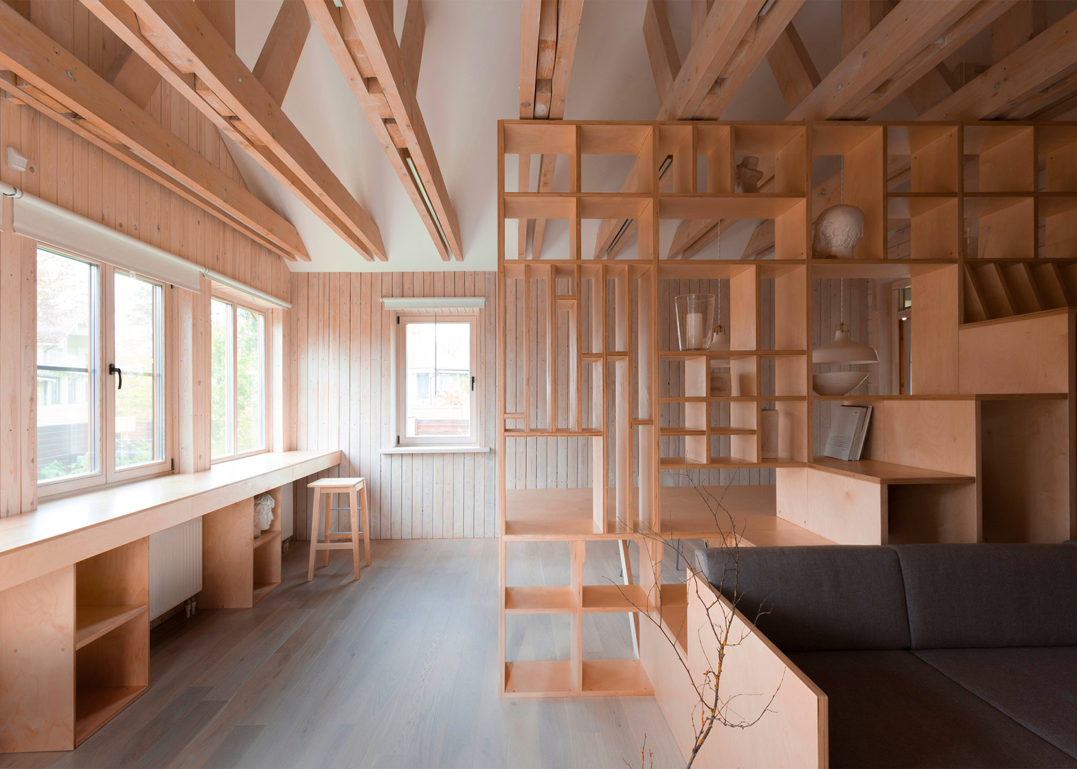 A Plywood Partition Separates Working And Relaxation Areas Inside This Artistu0027s  Studio In Moscow, Incorporating Both Furniture And Shelves For Tidying Away  ...