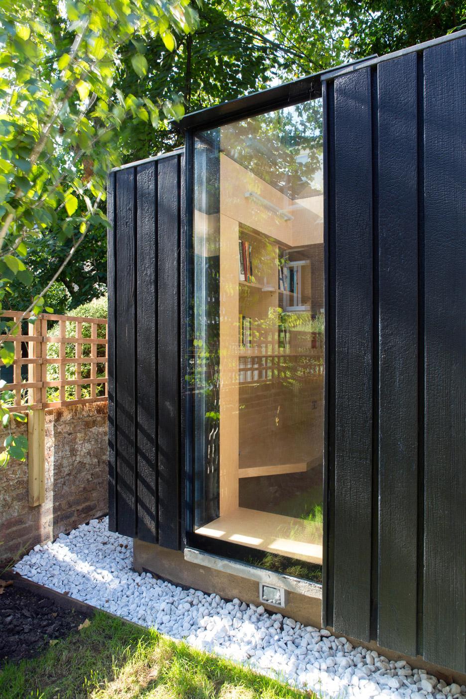 Garden room by neil dusheiko features walls of charred for Garden studio designs